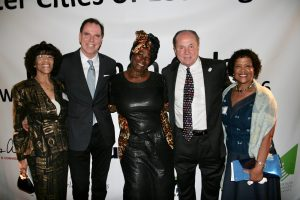 SCOLA Chairman Tom Gilmore and former L.A. City Councilman Tom LaBonge with members of the Los Angeles Lusaka Sister City Committee