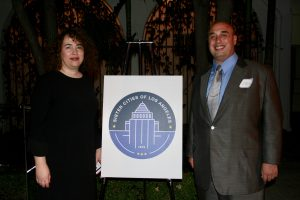 SCOLA Executive Director Fabiola Vilchez and Sister Cities International SoCal President Anthony Al-Jamie with the new logo for Sister Cities of Los Angeles